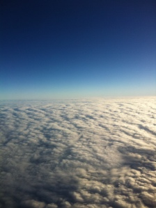 Somewhere high above the Pacific Ocean towards the United States